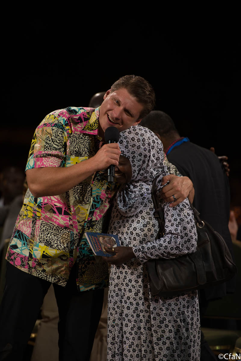 This woman had asthma for 15 years and can breathe properly now. She also got saved tonight, she carries the Now that you are saved booklets in her hands.